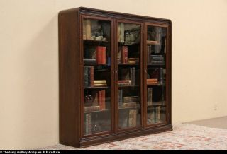 Triple Oak 1915 Antique Bookcase Wavy Glass Doors Adjustable Shelves