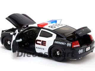 Jada Heat 1 24 2006 Dodge Charger Police w Stock Wheels